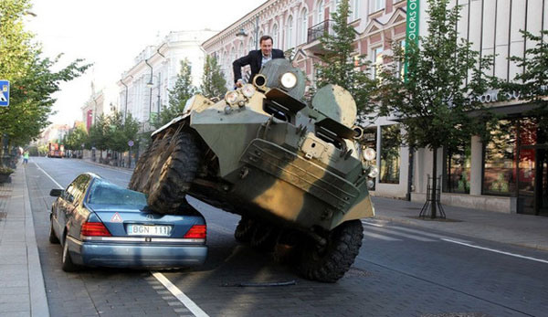 Park In a Bike Lane In Lithuania, Have Your Car Crushed by a Troop Carrier
