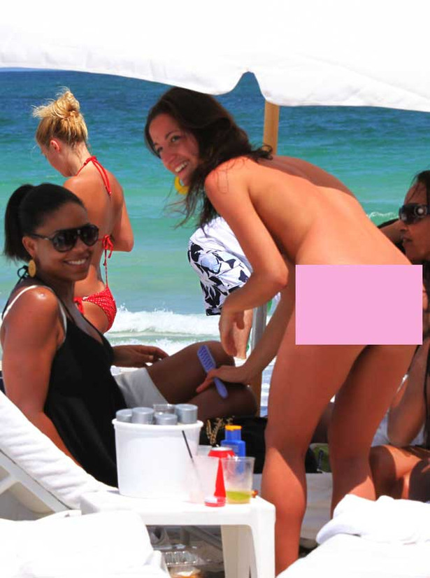 Sanaa Lathan Hangs with Topless Bikini Girl